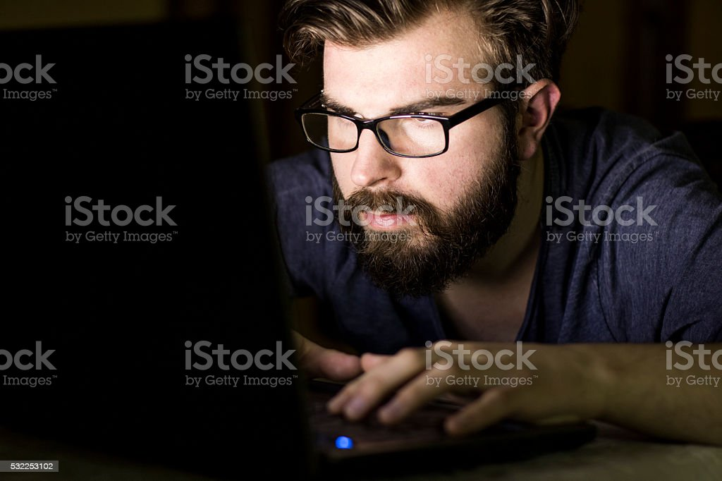 Working on laptop late night stock photo