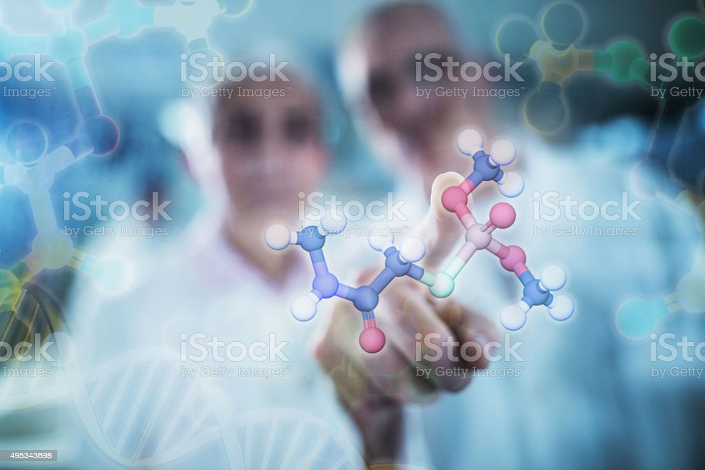 Working on molecular structure on touch screen. stock photo