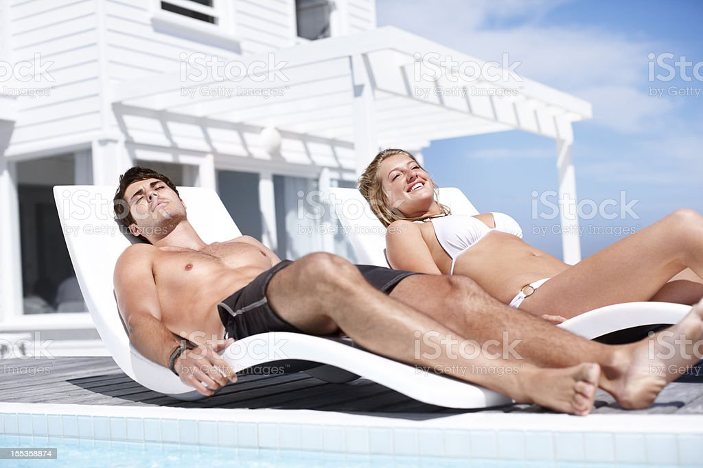 Working on our tans royalty-free stock photo