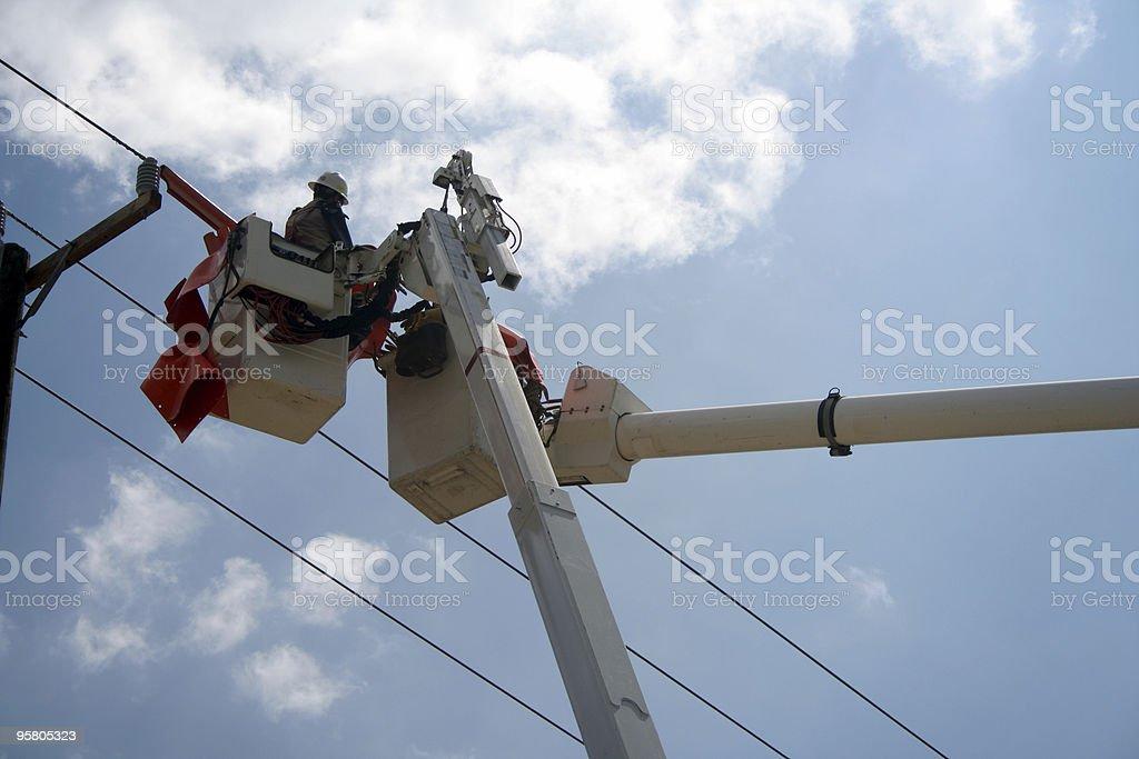 Working on Power Lines II stock photo