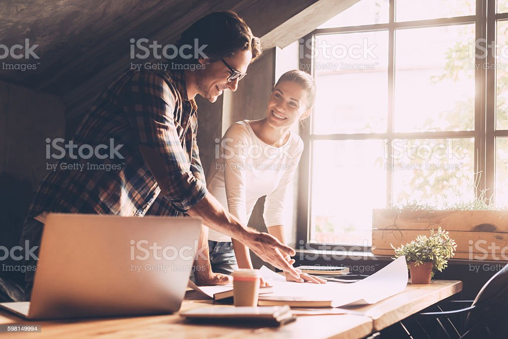 Working on project together. stock photo
