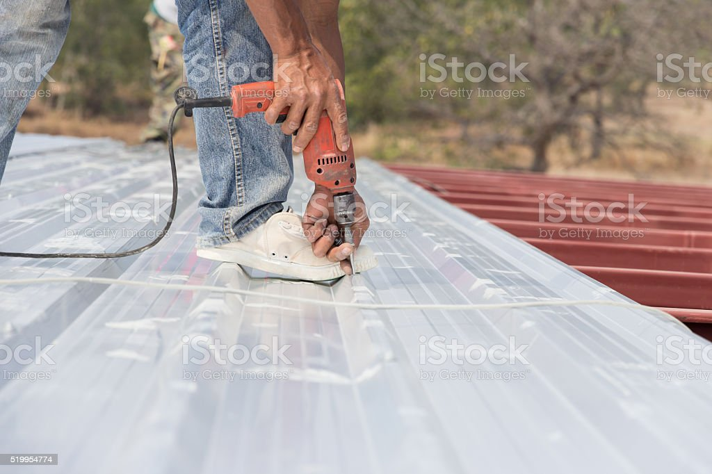 working on roof Metal cheese stock photo