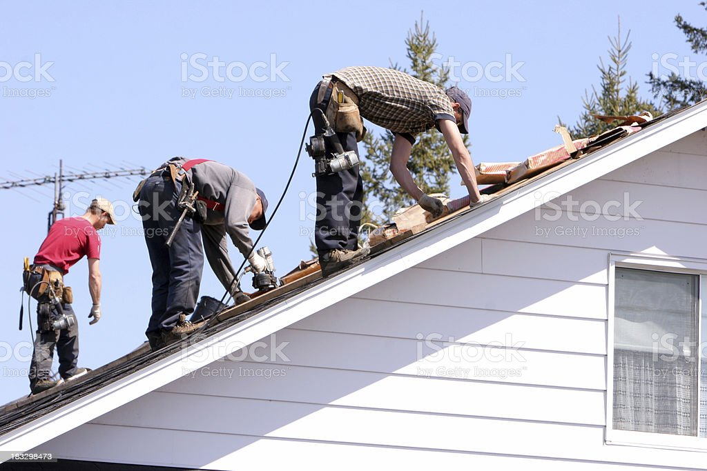 Working on roof stock photo