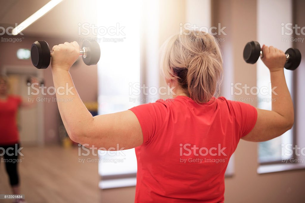 Working on shoulders in this age is important for women stock photo