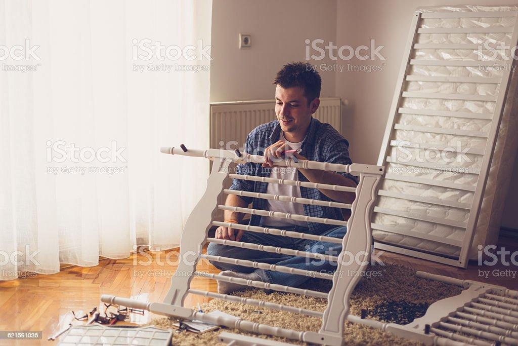 Working on the baby crib stock photo