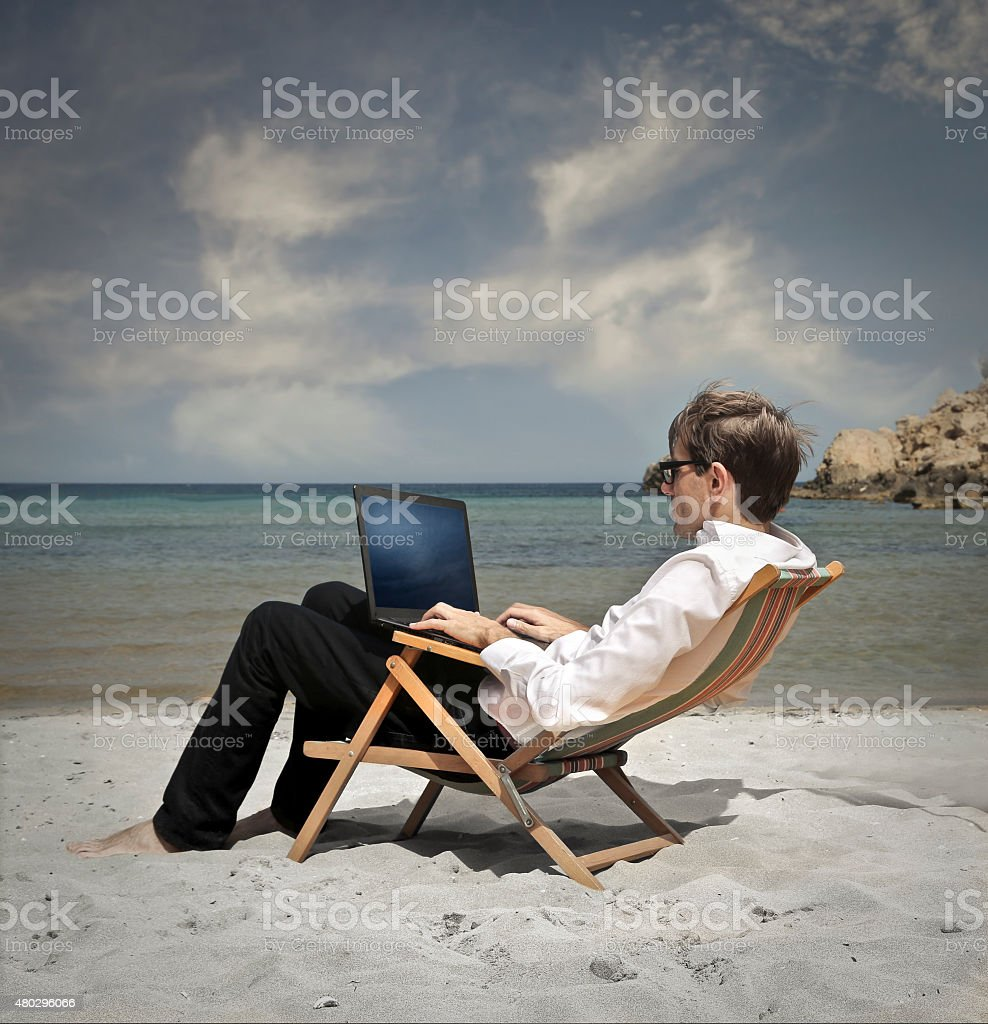 working on the beach stock photo
