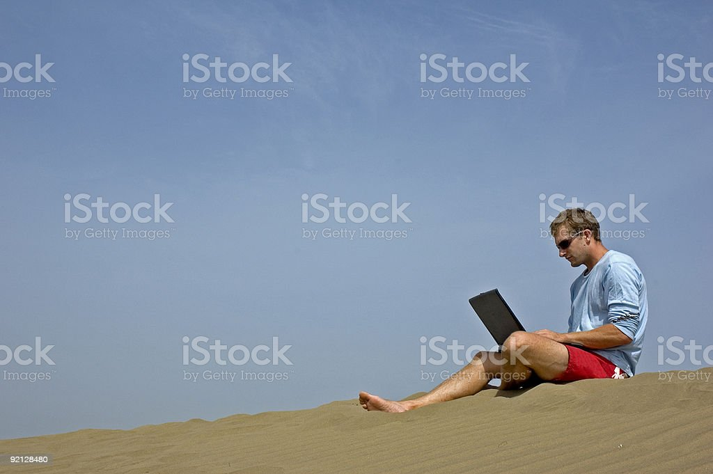 working on the beach5 royalty-free stock photo