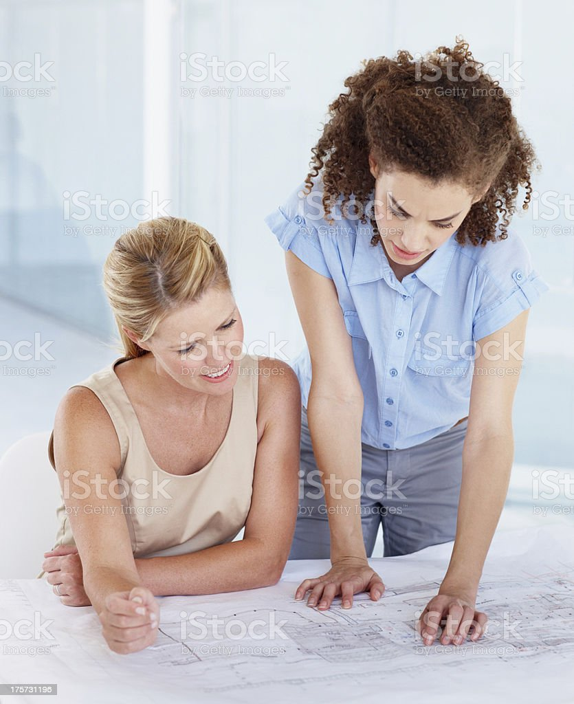 Working on the blueprints royalty-free stock photo