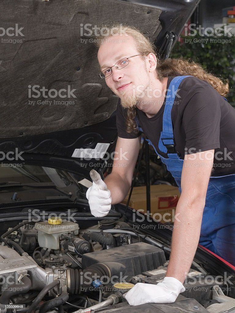 Working on the car - thumbs up! royalty-free stock photo