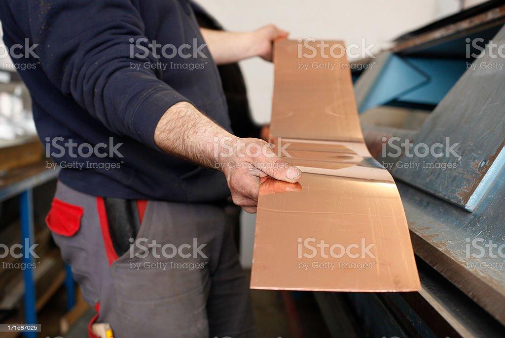 Working on the sheet metal bender stock photo