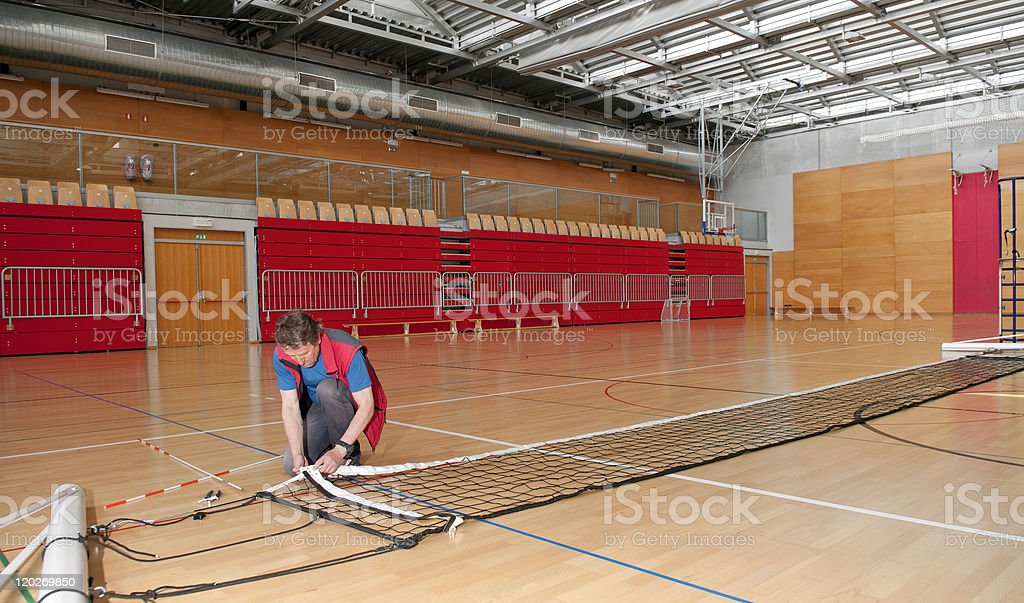 Working on Volleyball Net royalty-free stock photo