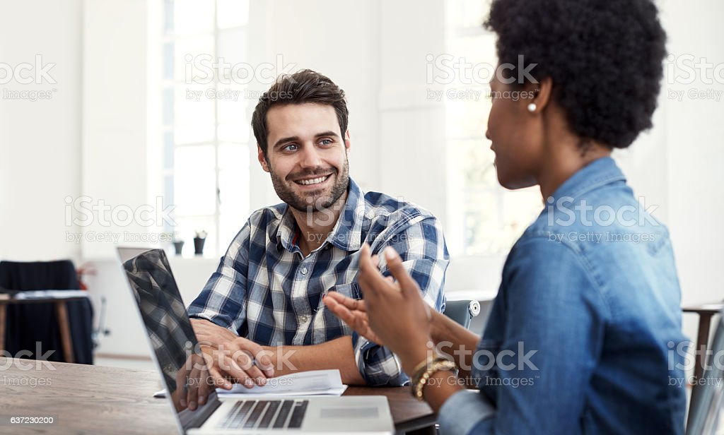 Working on ways to reach more potential clients stock photo