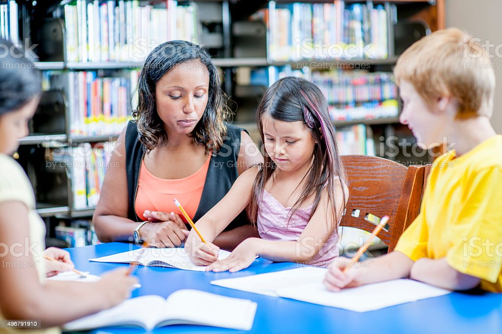 Working on Writing in the LIbrary stock photo