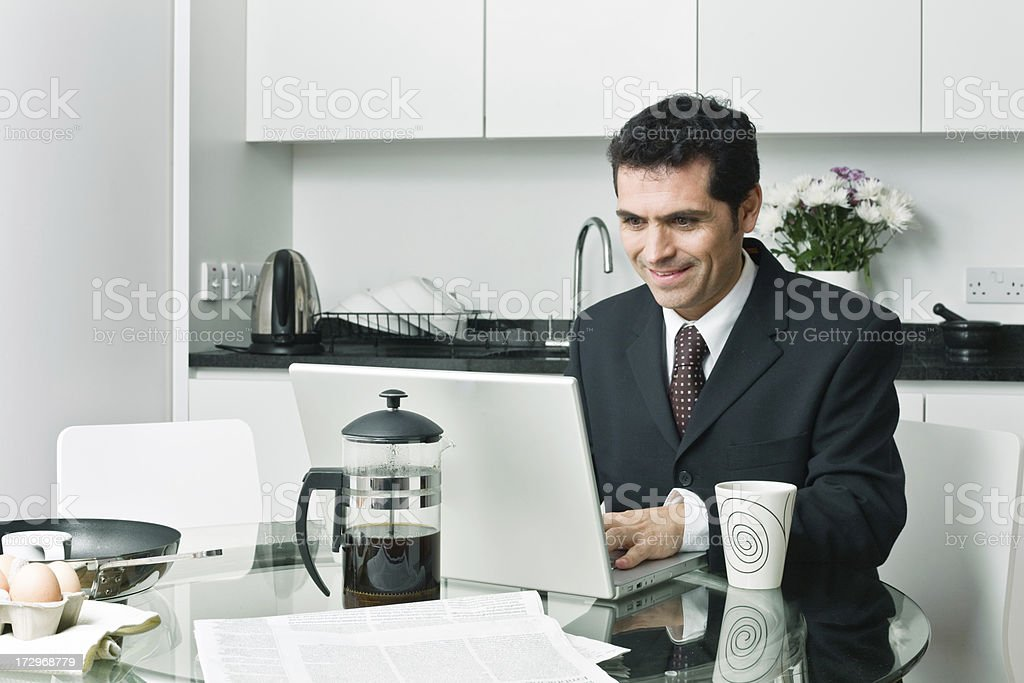 Working online with a cup of coffee royalty-free stock photo