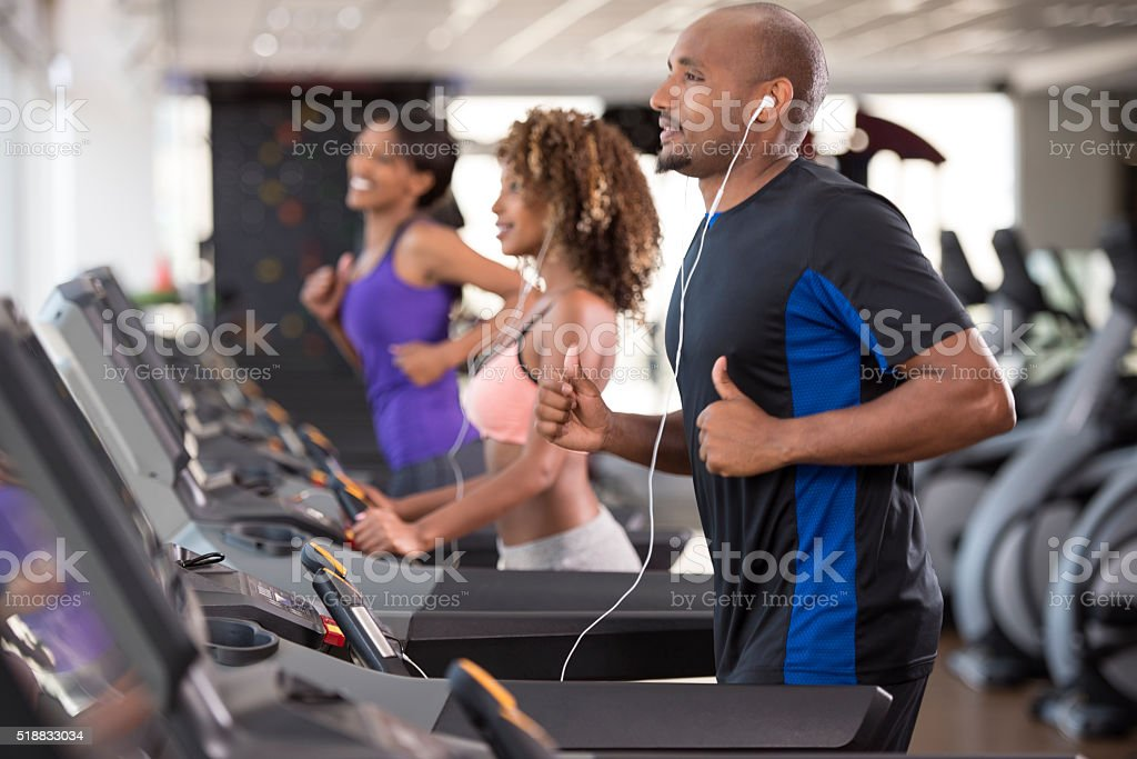 Working out at health club. stock photo