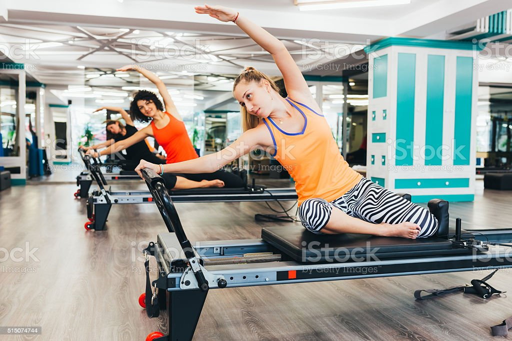 Working out in a pilates room stock photo