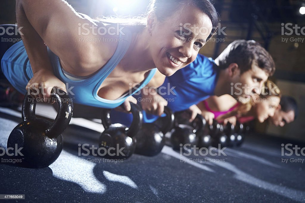 Working out in group strengthens her resolve royalty-free stock photo