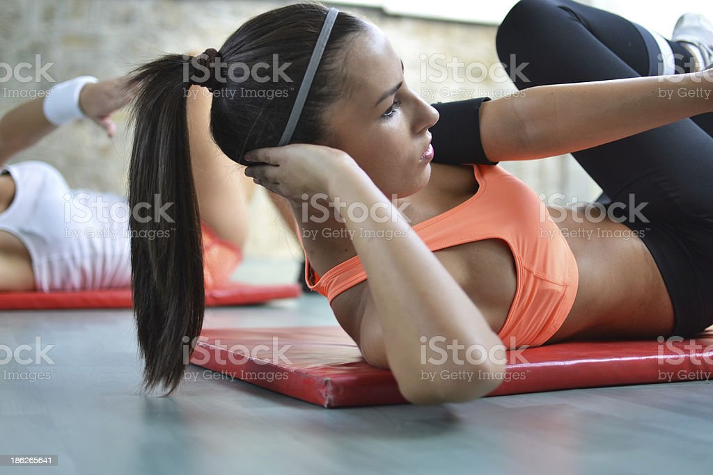 working out in the fitness studio stock photo