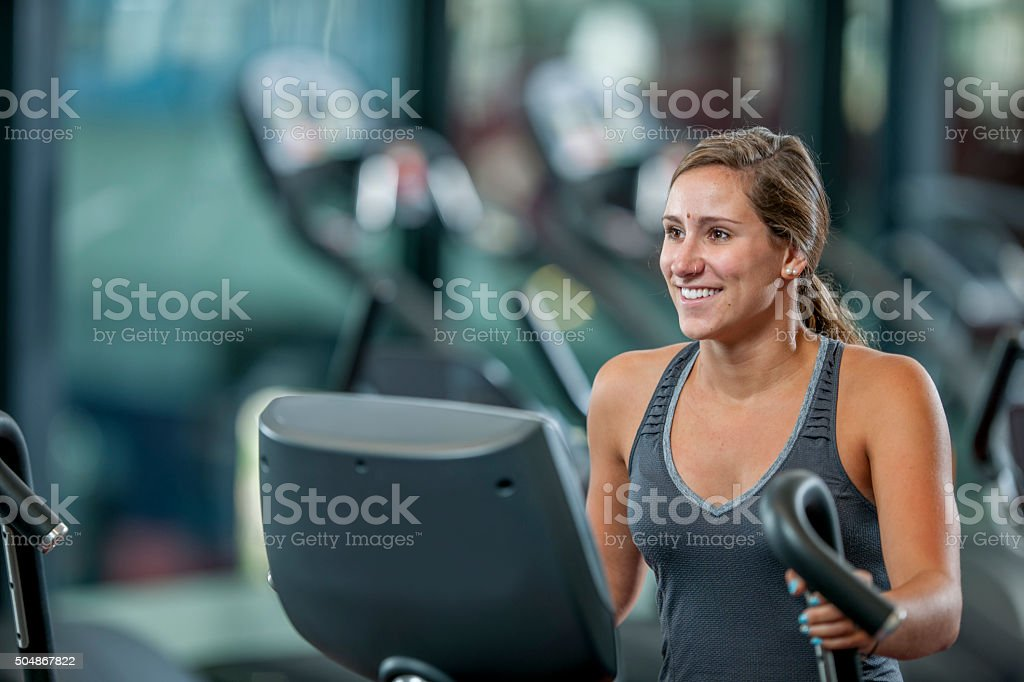 Working Out on a Machine at the Gym stock photo