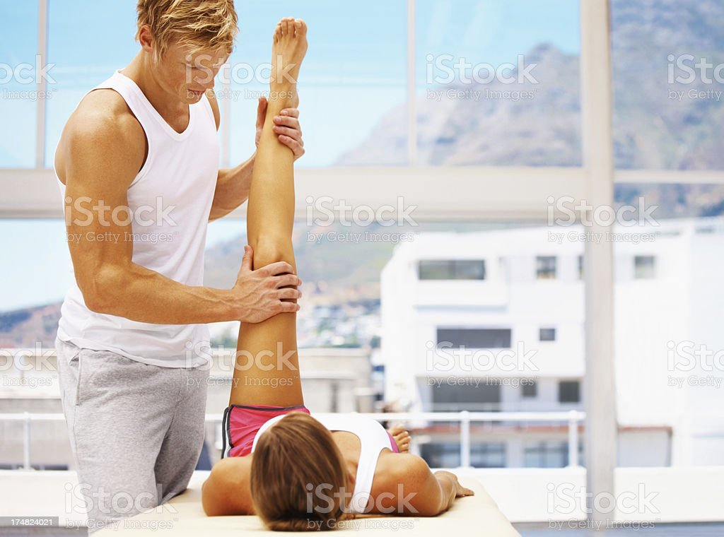 Working out the tension in her legs royalty-free stock photo
