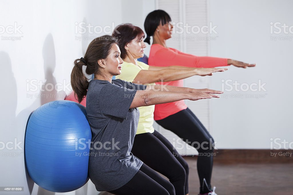Working out with fitness ball stock photo