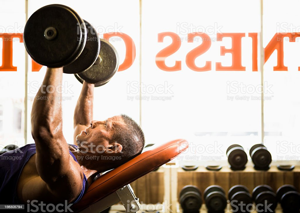 Working Out With Free Weights royalty-free stock photo