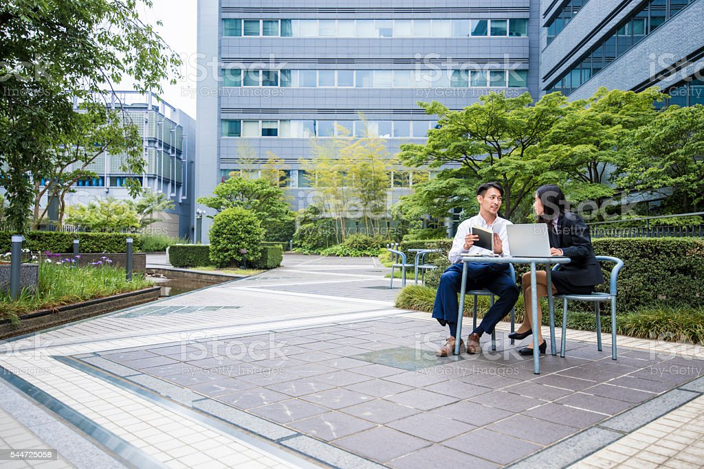 Working outdoors helps them to be more productive stock photo
