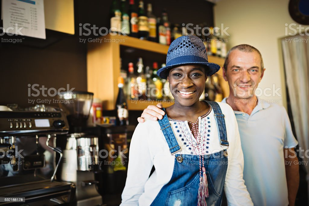 Working people in coffee shop stock photo