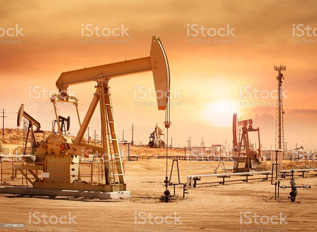 Working pump jacks at oil field stock photo