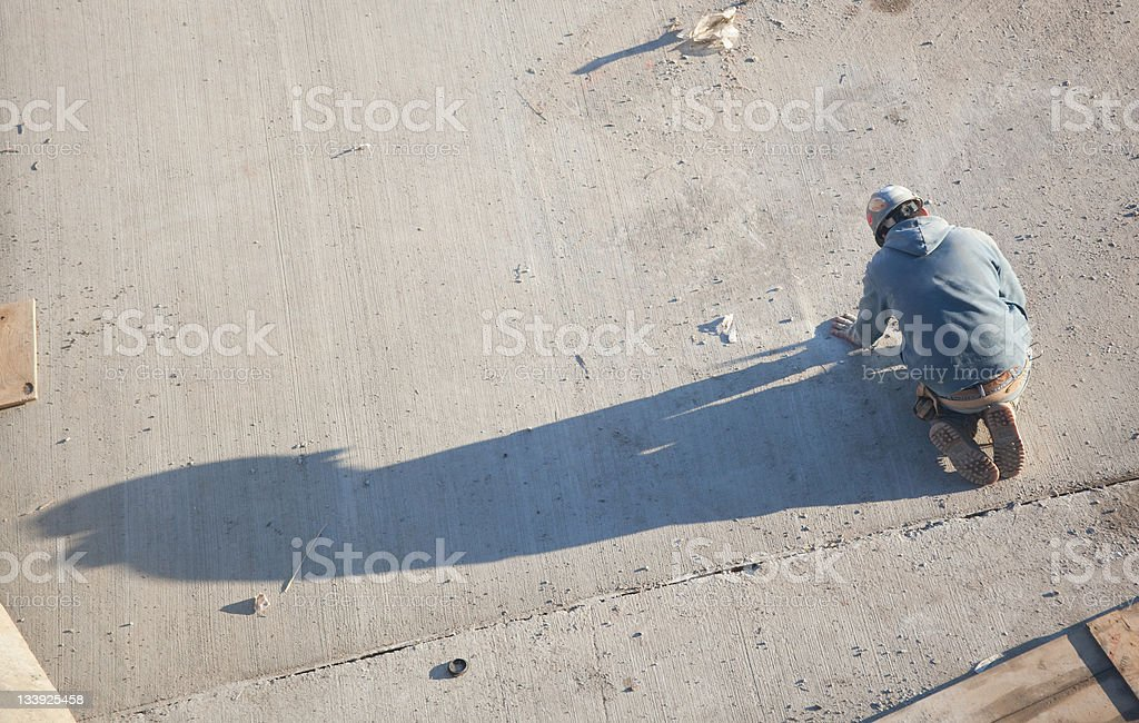 working repairman with the strange shadow royalty-free stock photo