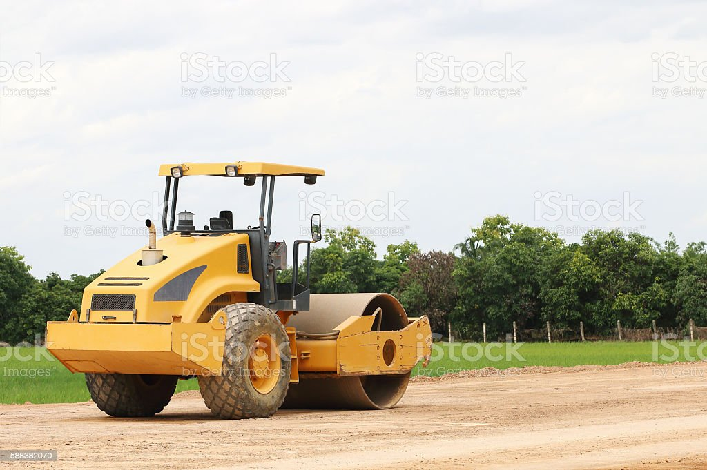 working road roller on ground stock photo