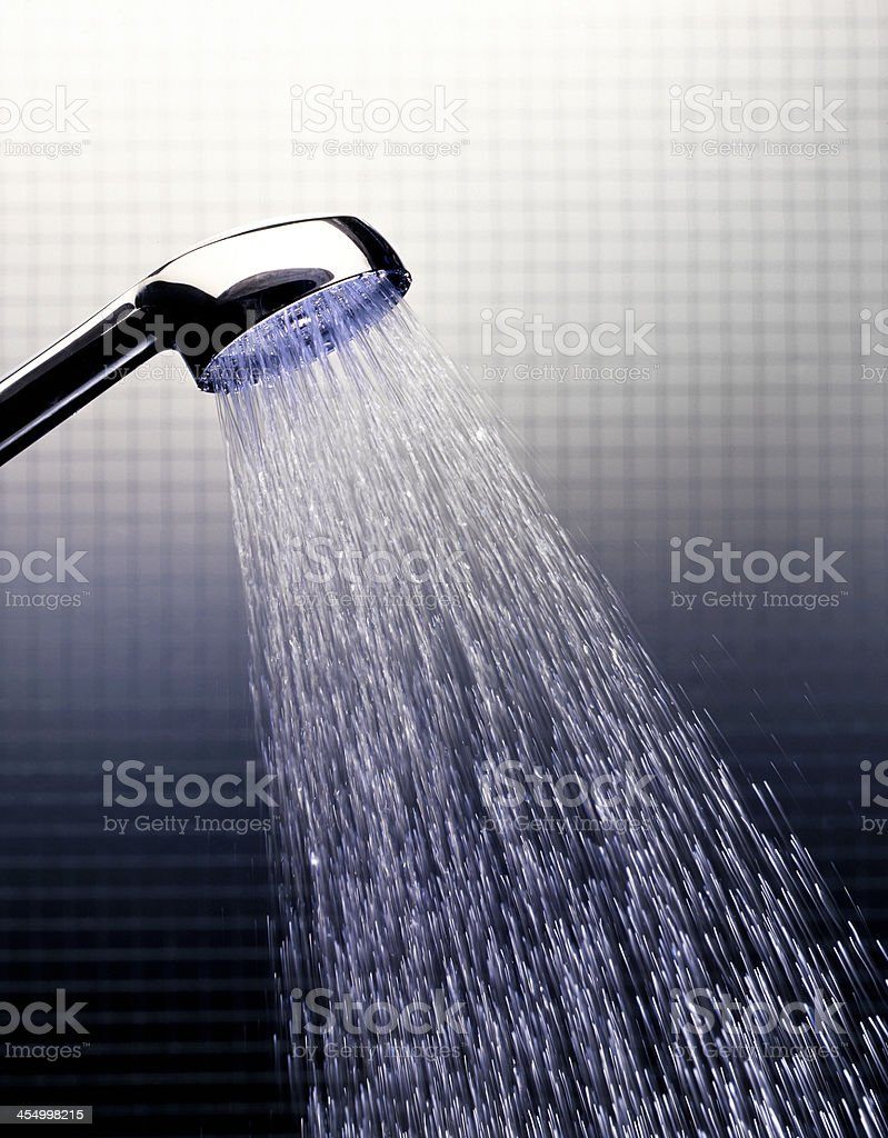 working shower in studio setting royalty-free stock photo