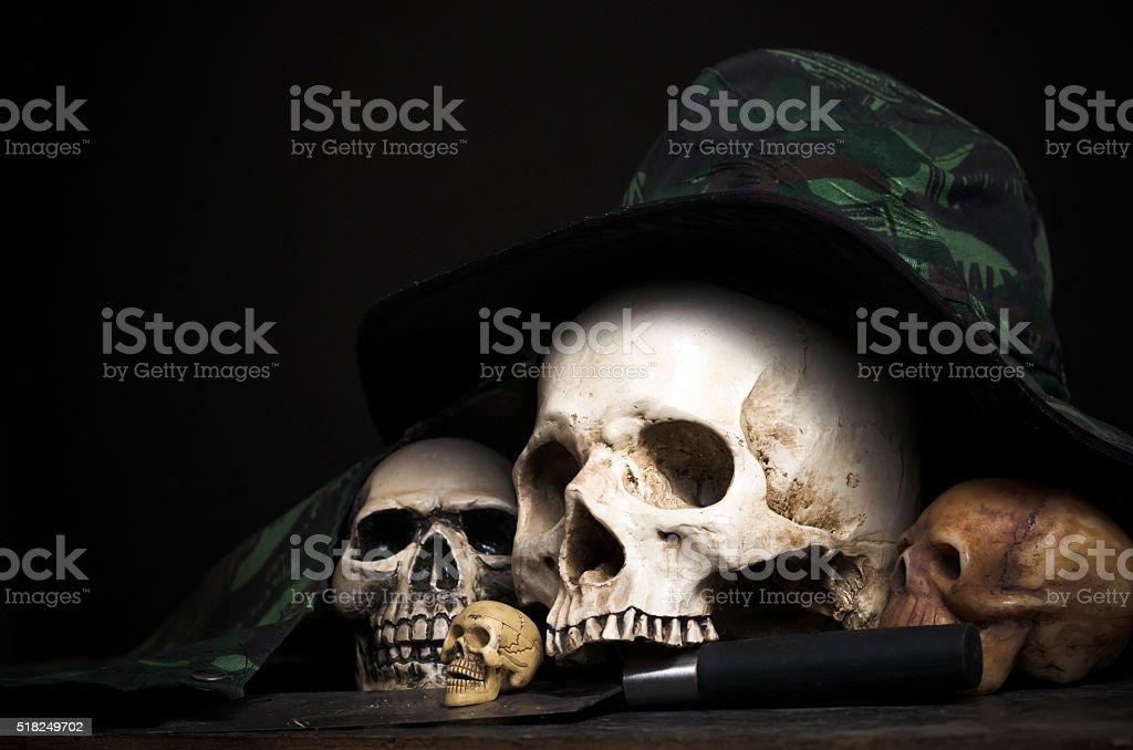 working skulls in hat stock photo