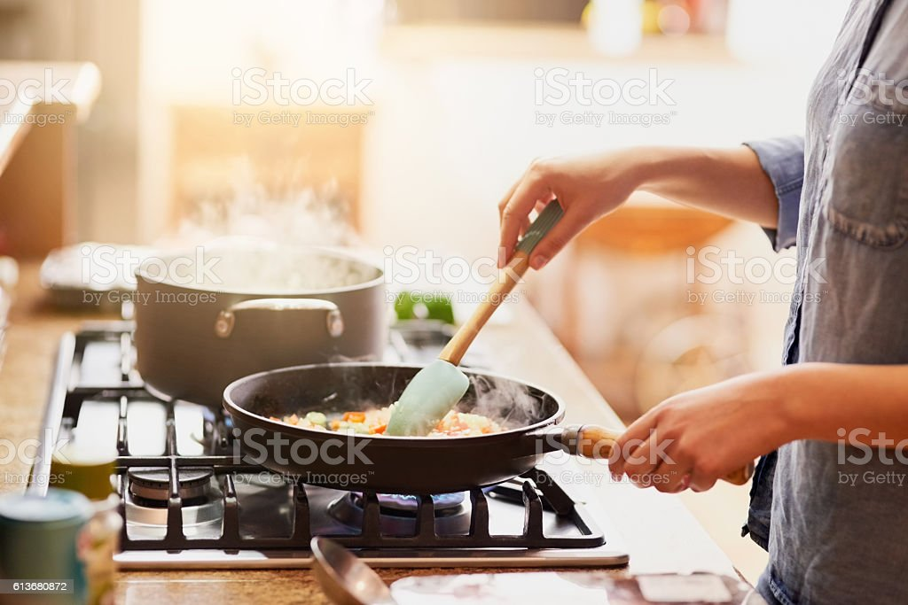 Working some magic in the kitchen stock photo
