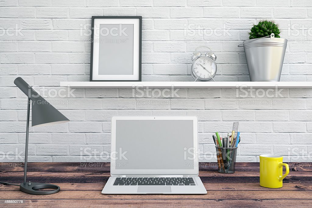 Working station with a laptop and accessories stock photo