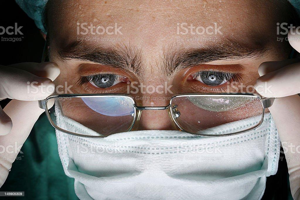 working surgeon royalty-free stock photo