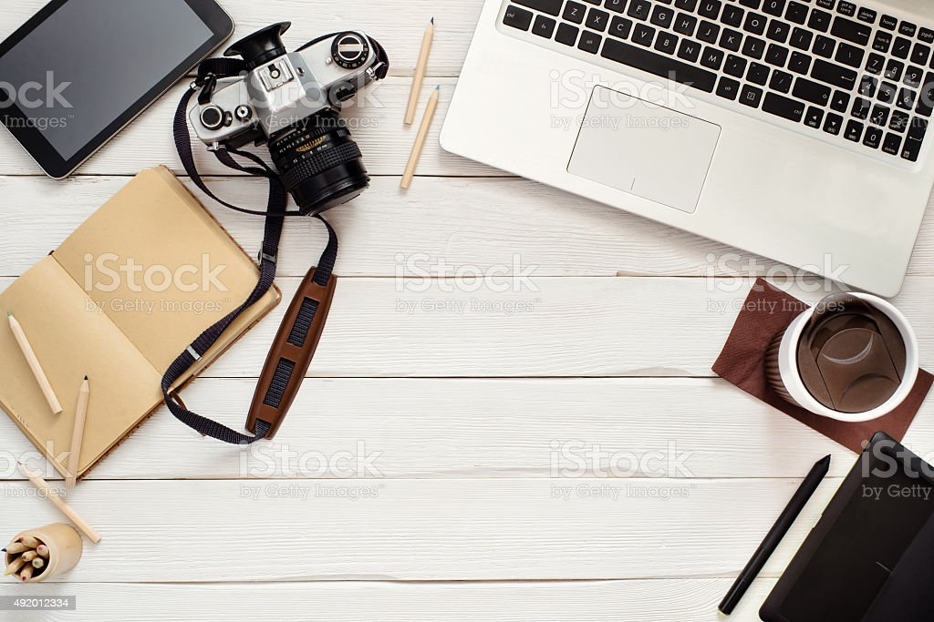 Working table of photographer or artist overhead view stock photo
