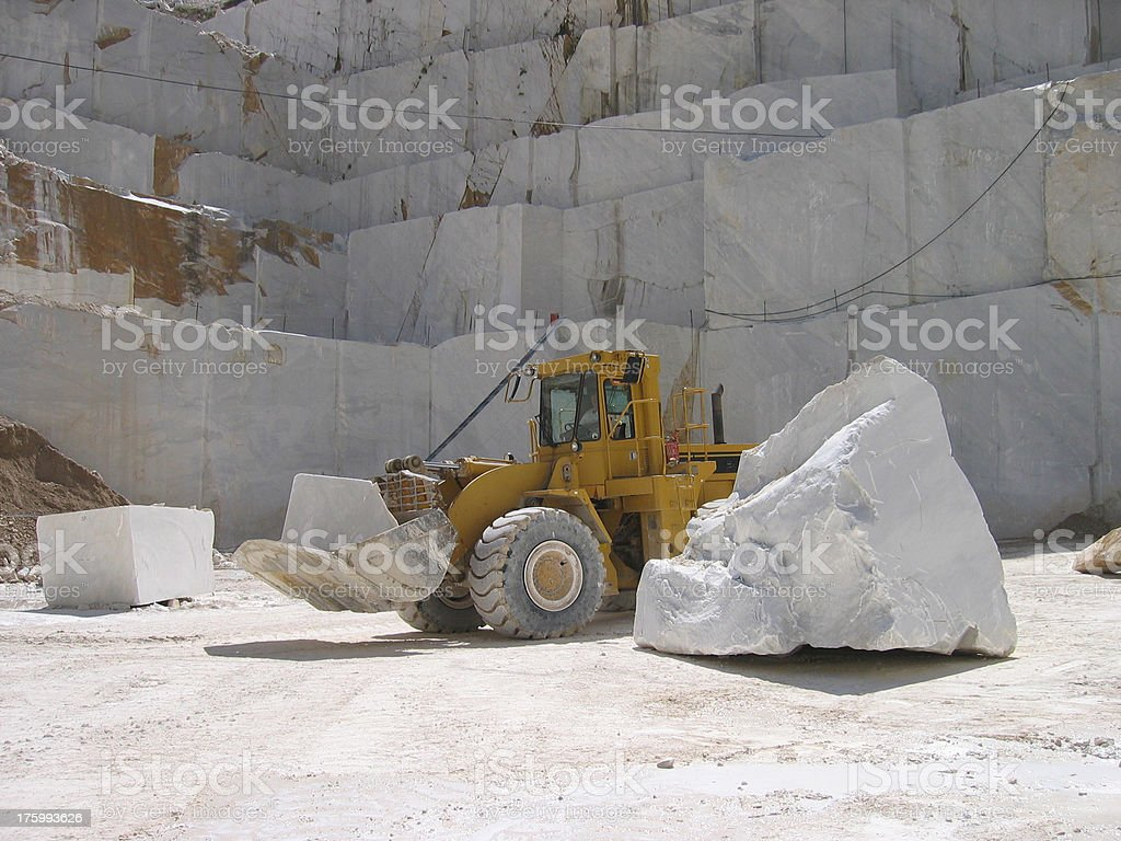 Working the Marble Quarry - Italy stock photo