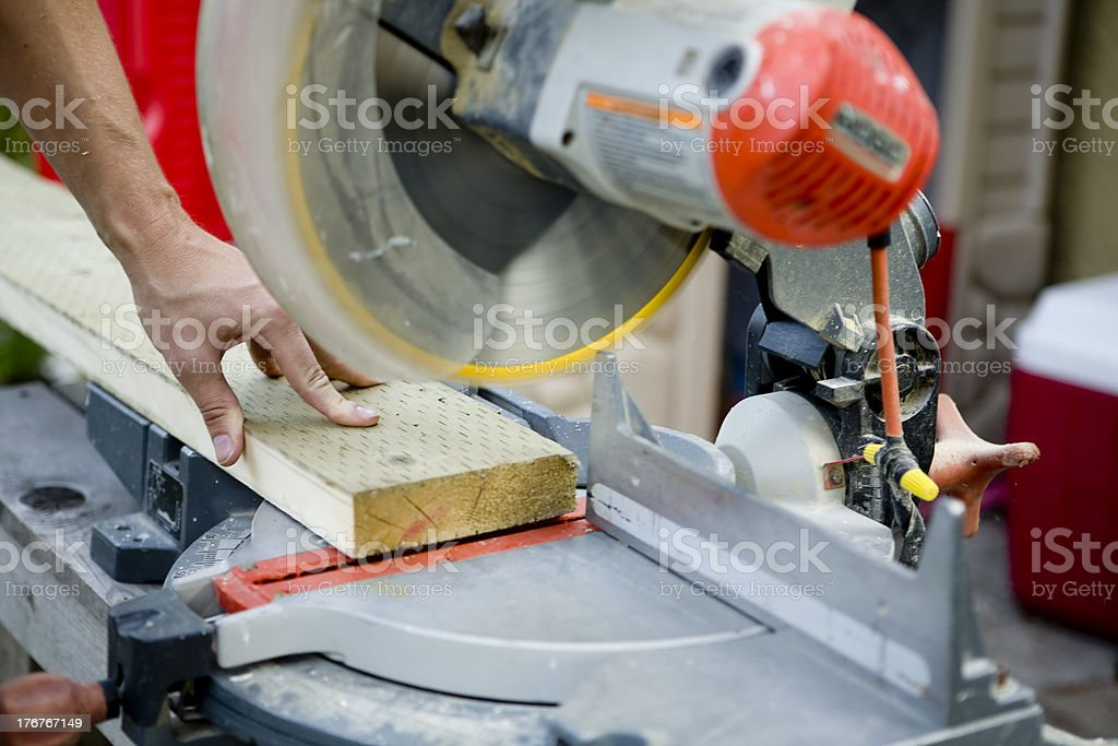 Working the miter saw stock photo