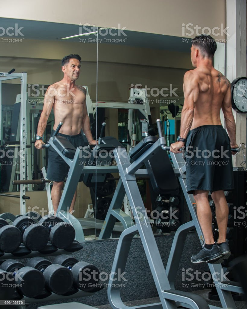 Working the triceps with intensity. stock photo