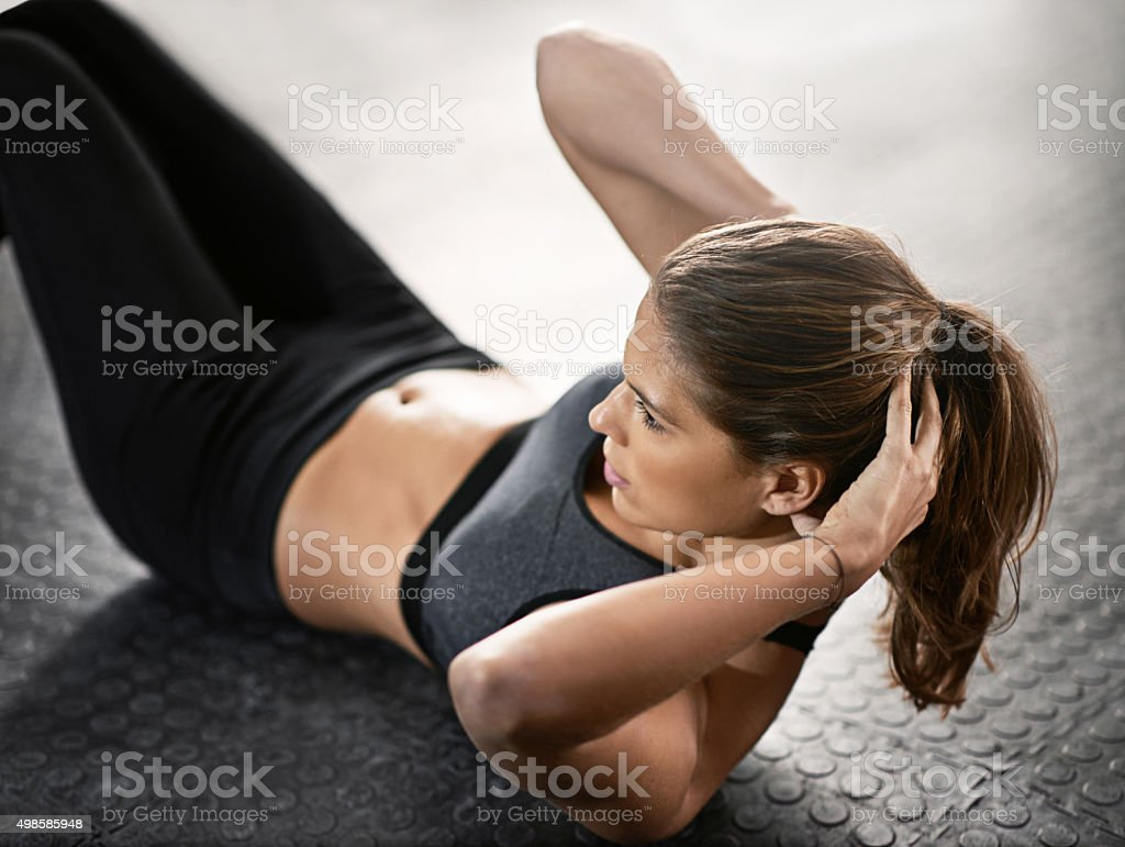 Working those core muscles stock photo
