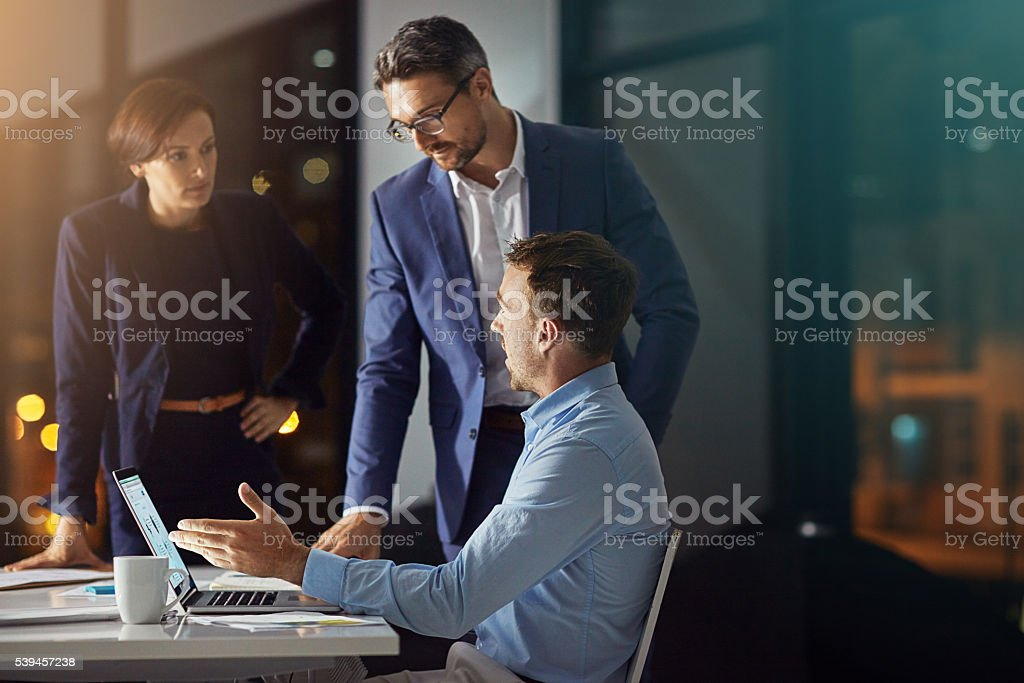 Working through the night to achieve a collective goal stock photo