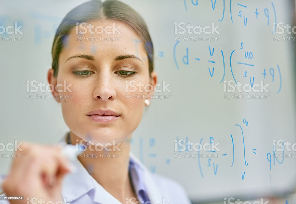 Working through the problem to uncover a solution stock photo