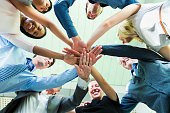 Working together.... hands of business team showing unity