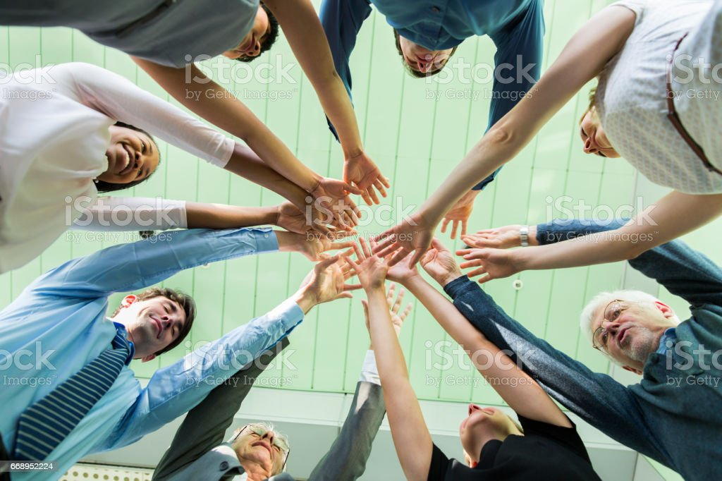 Working together.... hands of business team showing unity stock photo