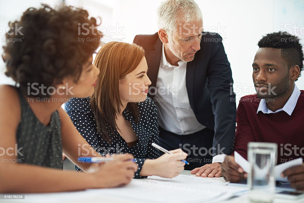 Working together to ensure success stock photo