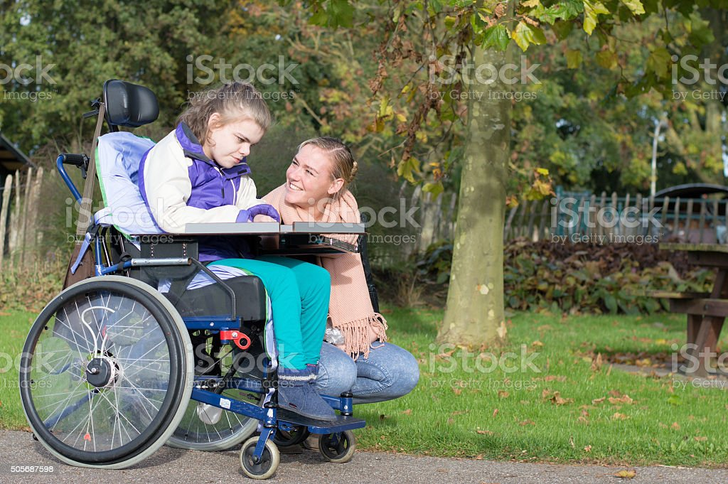 Working together with disability stock photo