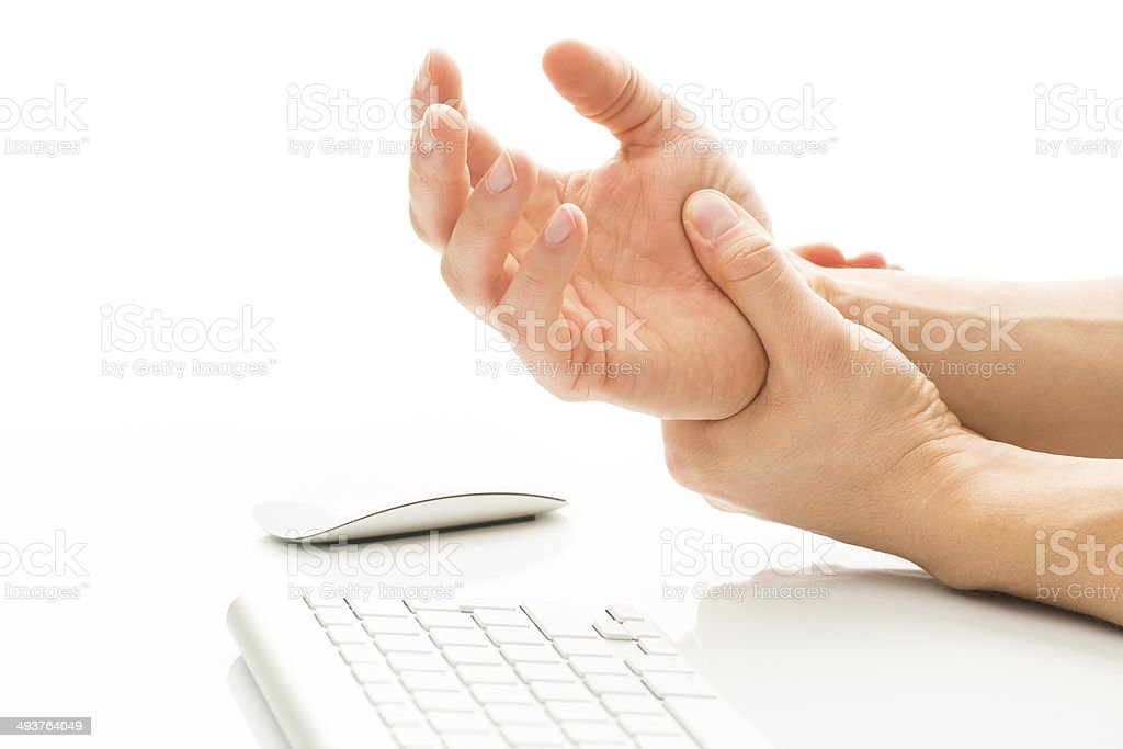 Working too much - suffering from a Carpal tunnel syndrome stock photo