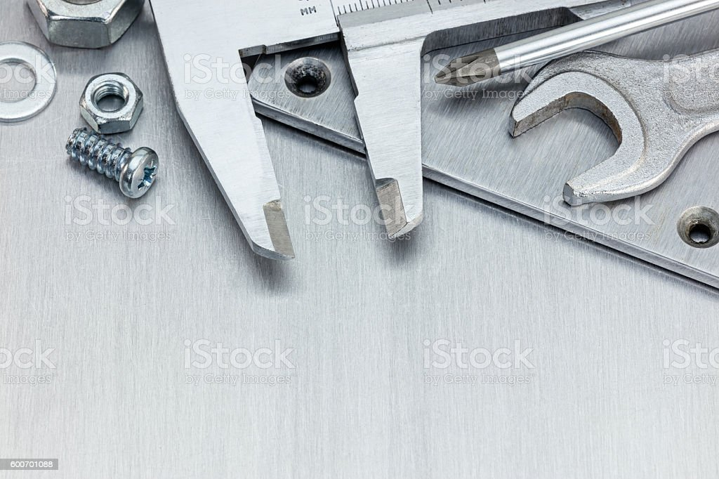 working tools for repair and fixing on scratched metal background stock photo