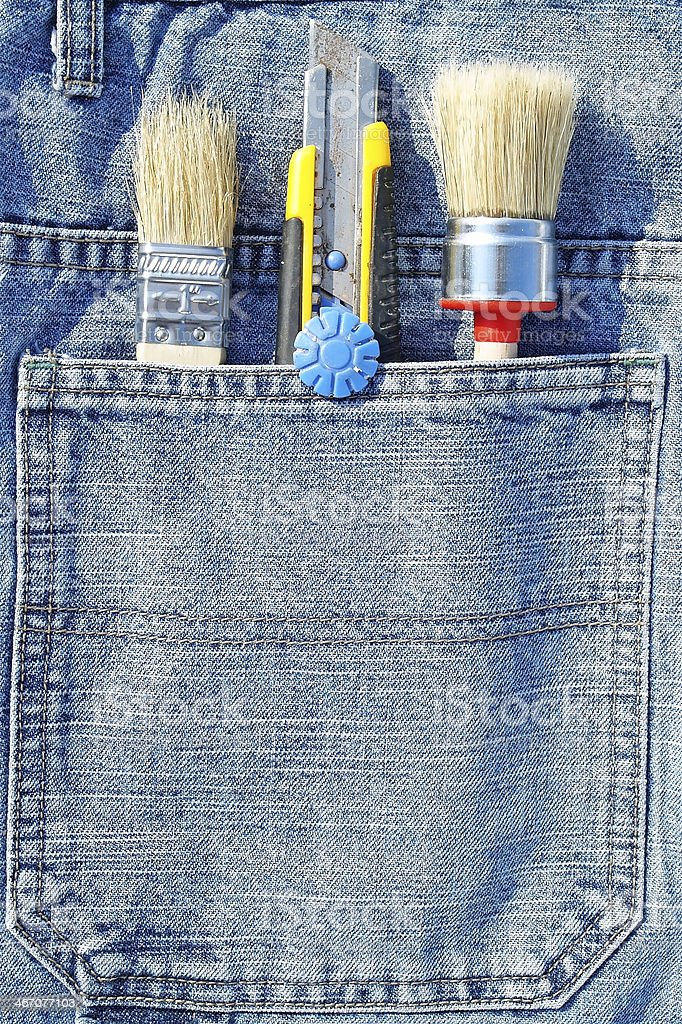Working tools in jeans pocket stock photo